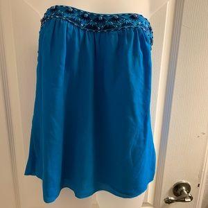 Strapless blue chiffon top.